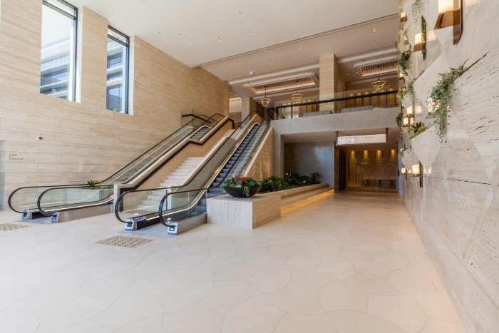 Travertine Walls & Staircase by Aurora Stone